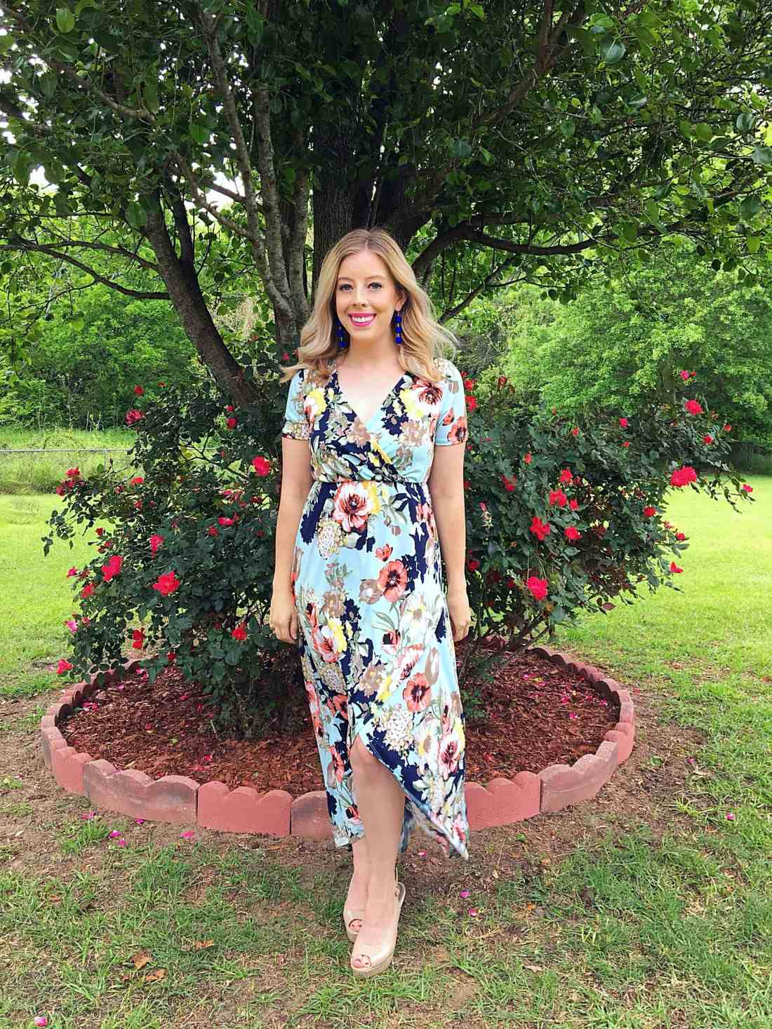 Looking for the perfect dress to buy for spring? This beautiful spring floral maxi dress features a gorgeous floral print, pastel colors, and a tulip hemline that is universally flattering. This beautiful maxi works great for both special occasions or casual events and pairs nicely with fun, spring accessories.
