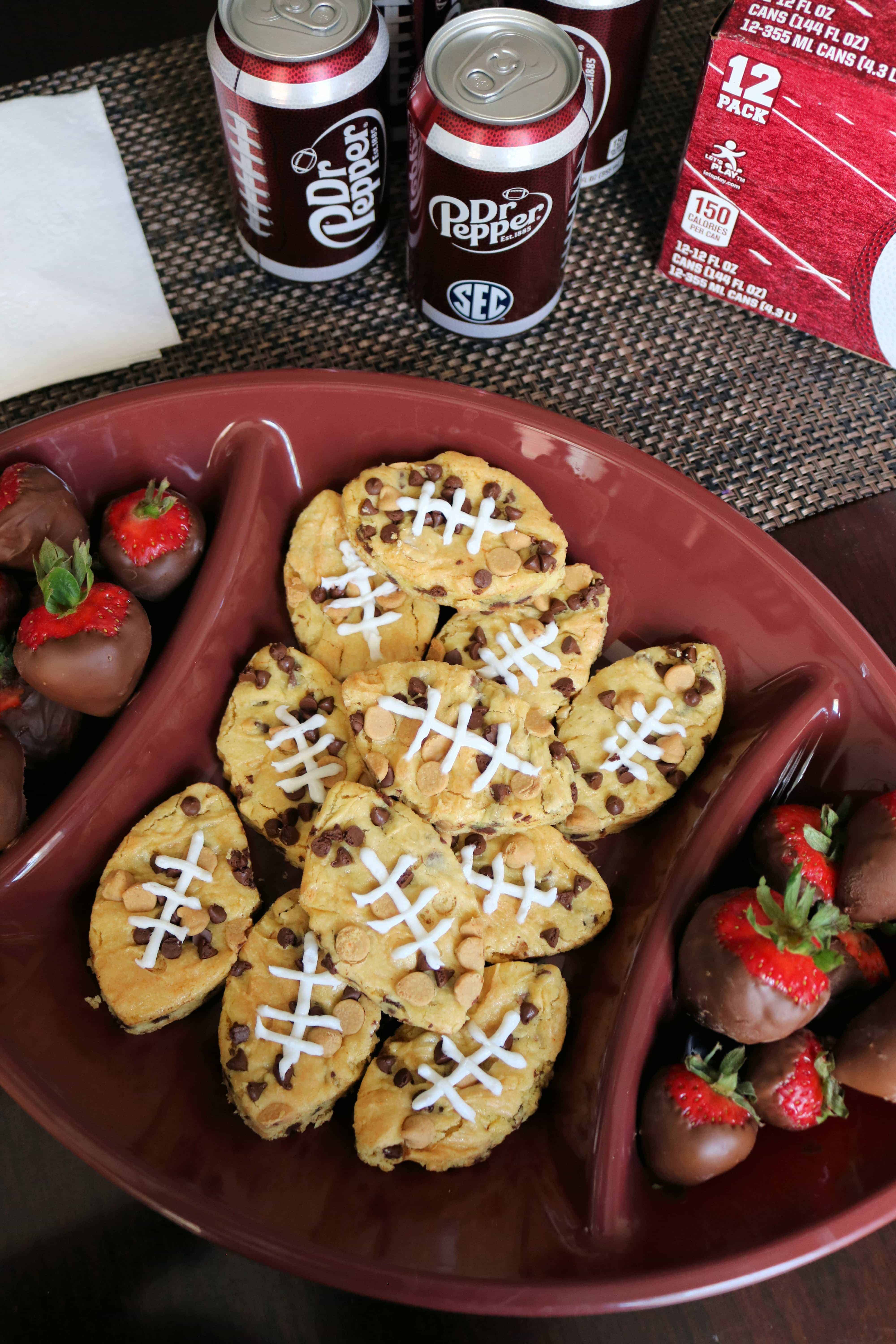 Looking for a yummy and easy tailgating dessert for your next football party? Then try these Easy Football Chocolate Chip Peanut Butter Blondies! This is the best blondies recipe around and guests will love the cute football shape! Pair them with some delicious Dr Pepper® from Publix, chocolate covered strawberries, and you've got the perfect game day menu!#ad #MyPublixWin #DrPepper #blondies #peanutbutterblondies #blondiesrecipe #footballdesserts #tailgating