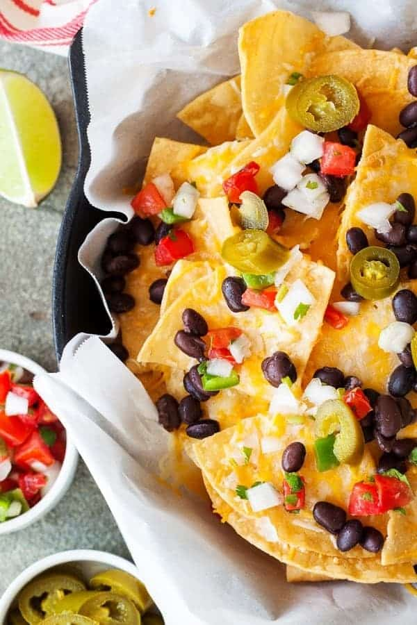 Delicious Skillet Nachos | Need food recipe ideas that everyone will love to eat at your next Super Bowl party? Check out my roundup of the 65 Best Super Bowl Party Food Recipes including easy and delicious appetizers, wings, dips, snacks, desserts, and more! #superbowl #partyfood #superbowlfood