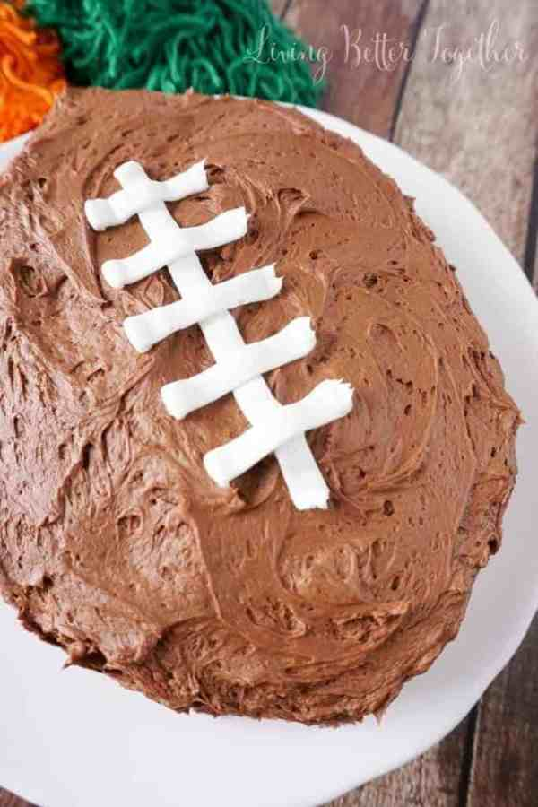 Easy Football Cake | Need food recipe ideas that everyone will love to eat at your next Super Bowl party? Check out my roundup of the 65 Best Super Bowl Party Food Recipes including easy and delicious appetizers, wings, dips, snacks, desserts, and more! #superbowl #partyfood #superbowlfood