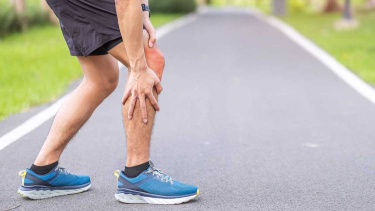 Young adult male with knee pain during running