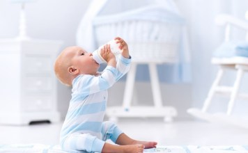 How to Get Your Child to Hold Their Own Bottle