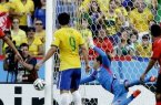 Ochoa makes one of his many saves against Brazil. [AP]
