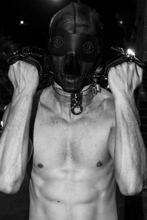 Facemask - stylist's own | Blindfolds - Zana Bayne | Choker - Zana Bayne | Handcuffs, piercing - model's own