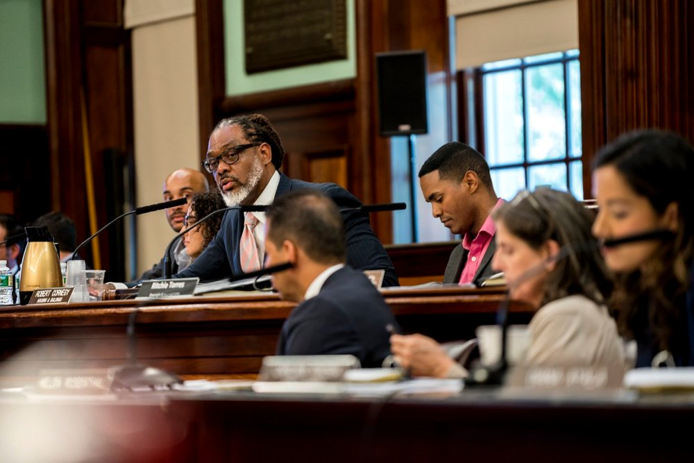 City Council member Robert Cornegy (center left), Jr. and Ritchie Torres (center right) lead the hearing. (Photo by Tsubasa Berg)