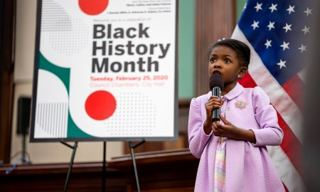 Cydnee Buggs singing the Star-Spangled Banner to start off the event. Photo by Tsubasa Berg