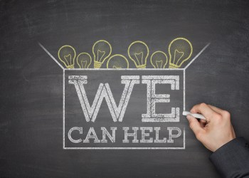 We can help on black blackboard with hand
