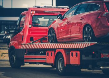 Close up of red car being towed. Photo from 123rf.