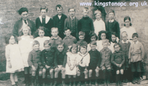 1920/21: Back row: Mrs. Cottrell, David Hunt, Harry Hansford, Fred Damer, Owen Audley, William Hickson, Alfie Green, Miss Moss  Middle row: Joyce Curtis, Linda Jeffries, Margaret Stickland, Ken Barnes, Philip Neale, George Bullen, Win Cooper, Mary Cooper, Nellie Hansford, George Stickland, Henry Kellaway  Front row: Fred Bullen, Edgar Hunt, Frank Hickson, Violet Moore, Jimmy Hansford, Raymond Hooper, William Simpson, Fred Collins