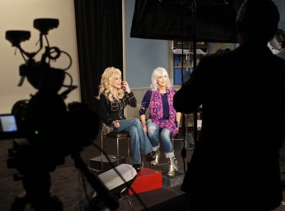 Dolly Parton and Emmylou Harris relax on-set during a promo shoot at Kingswood Productions in Nashville, Tenn.