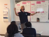 Video: Mr. Routhier Sings, Plays Air Guitar, to Get Students College-Ready