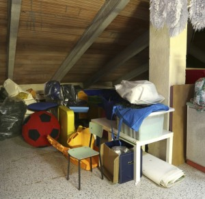 Attic with many things throw and clothes hung out to dry