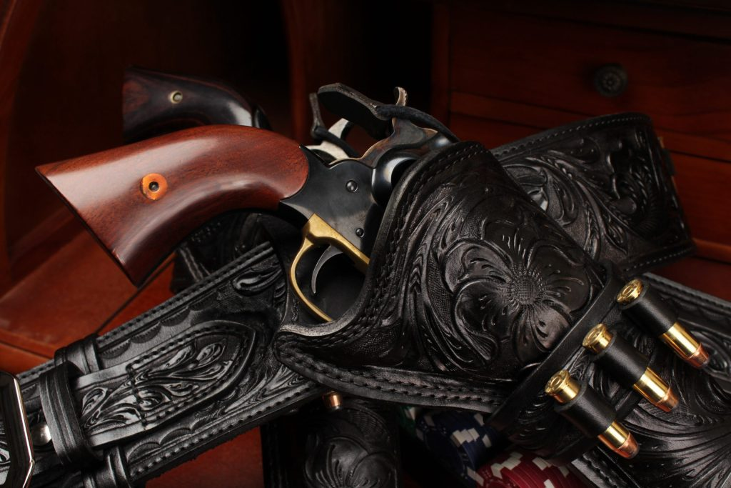 black leather cowboy action western holster hand tooled for single action revolver