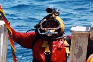Commercial diver emerging from the water
