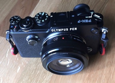 Pen with lens