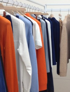 Rail of clothes, orange and blus