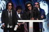 Simmons of the rock band Kiss speaks next to fellow band members Stanley, Criss and Frehley after Kiss was inducted at 29th annual Rock and Roll Hall of Fame Induction Ceremony in Brooklyn, New York
