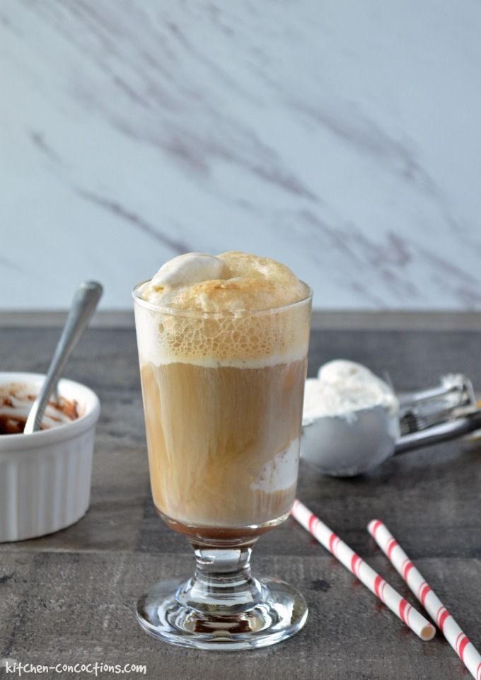 Mocha Root Beer Float in a tall dessert glass with an ice cream scoop and red and white paper straws on the side.