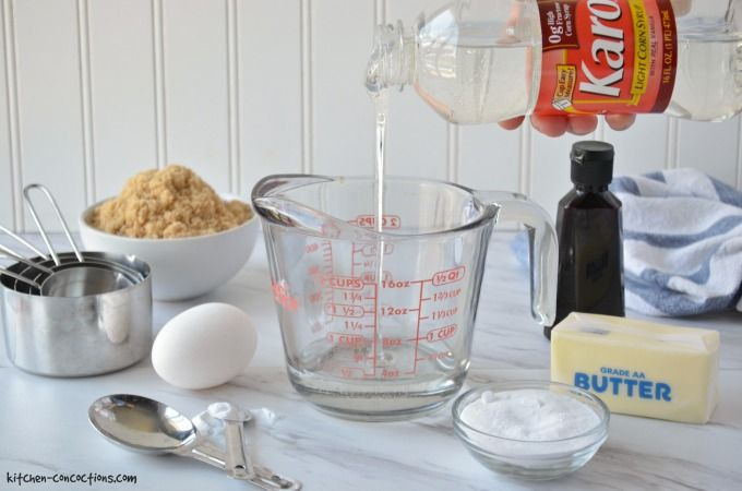 Karo corn syrup being poured into a glass measuring cup with other cookie ingredients on the side.