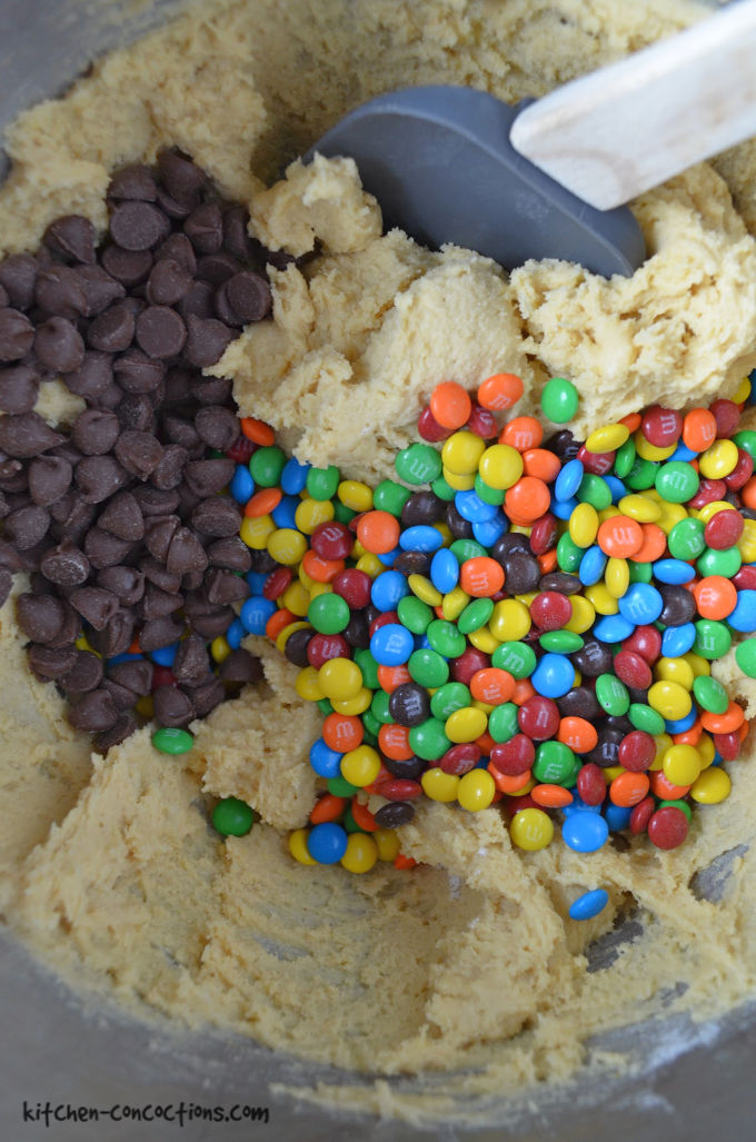 close up photo of M&M's Chocolate Chip Cookie dough in a kitchen aid mixer bowl