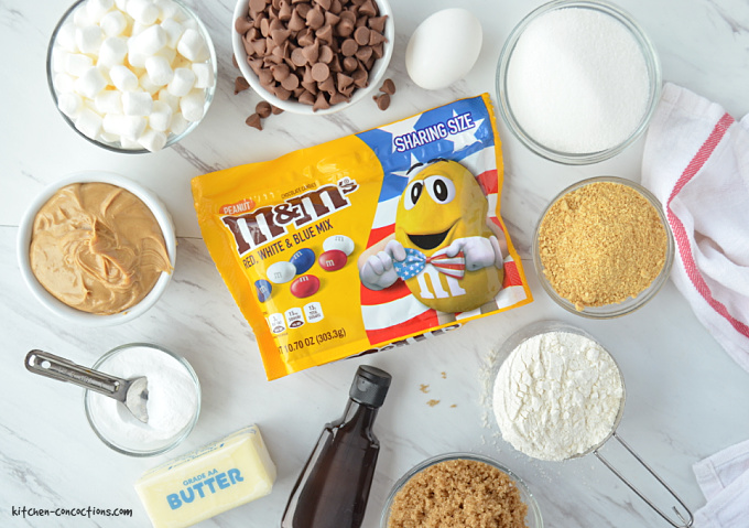 Peanut Butter S'mores Cookie ingredients portioned out into small white or glass bowls.