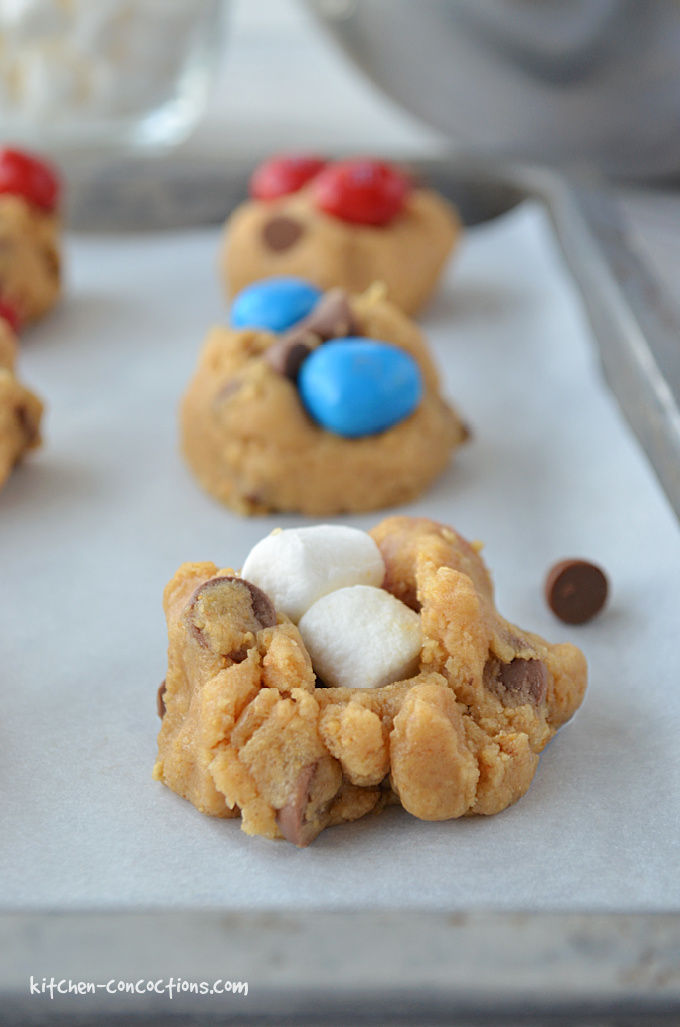 Peanut Butter S'mores Cookie dough portioned onto a cookie sheet.