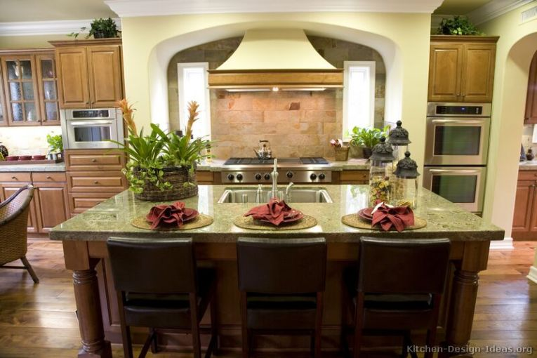 Kitchen Countertops Ideas   Photos   Granite  Quartz  Laminate This luxury kitchen has a warm color scheme  a large island  and beautiful  Seafoam