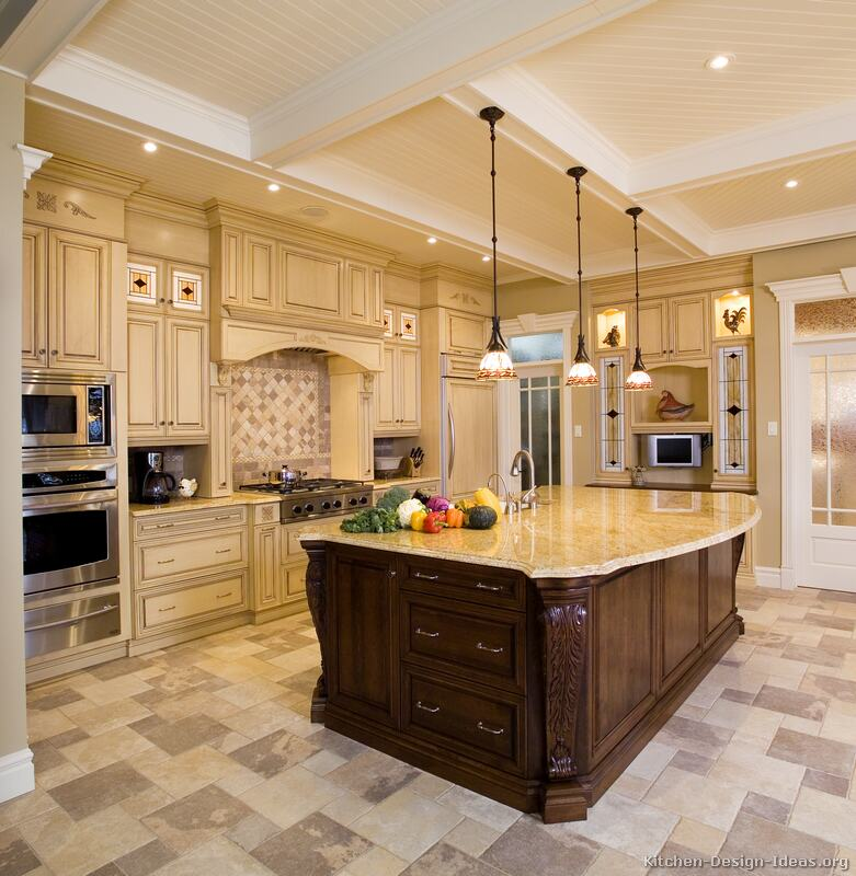 Luxury Kitchen Design with High Coffered Ceilings, Antique White Cabinets, and a Dark Wood Island