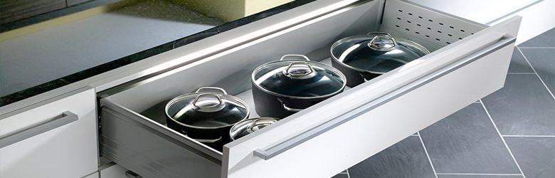 saucepans in kitchen drawer