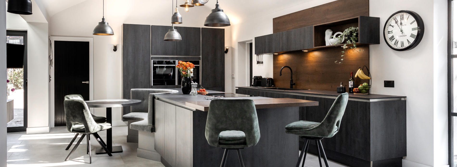 A dark industrial style kitchen with natural tones and textures