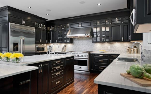 black cabinets and stainless steel appliances
