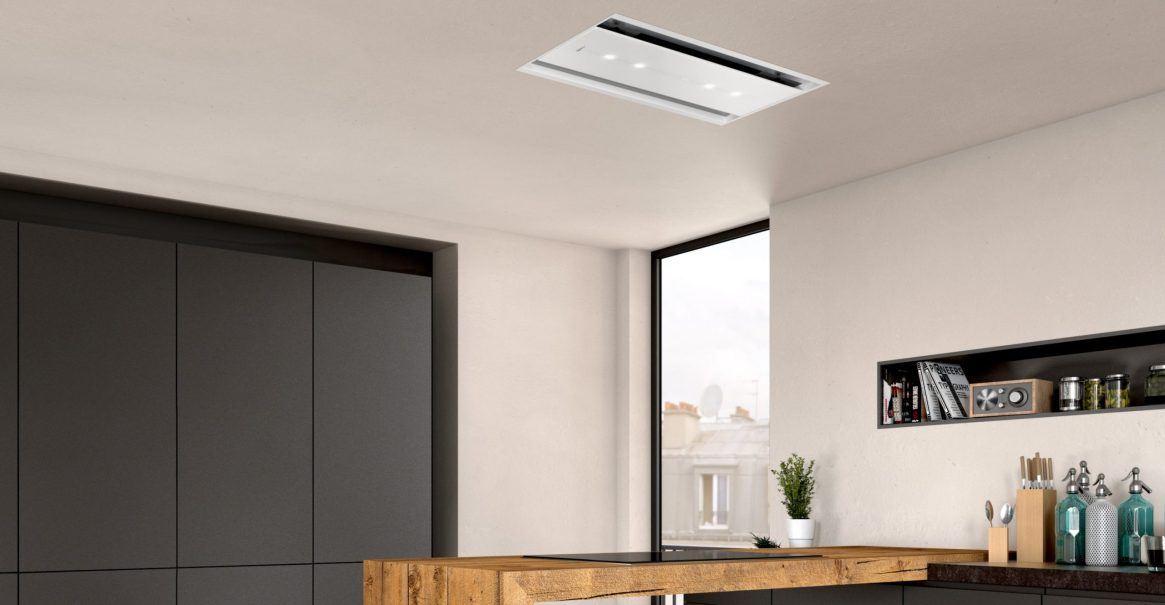 NEFF's 90cm ceiling cooker hood in white glass features Home Connect for remote operation via smartphone or tablet.