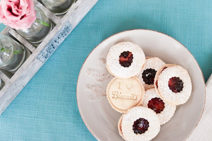Delicate and crisp almond shortbread are filled with cherry preserves and dusted with sugar. A total show stopper for the holidays! The real surprise though, is how easy this dough is to work with.