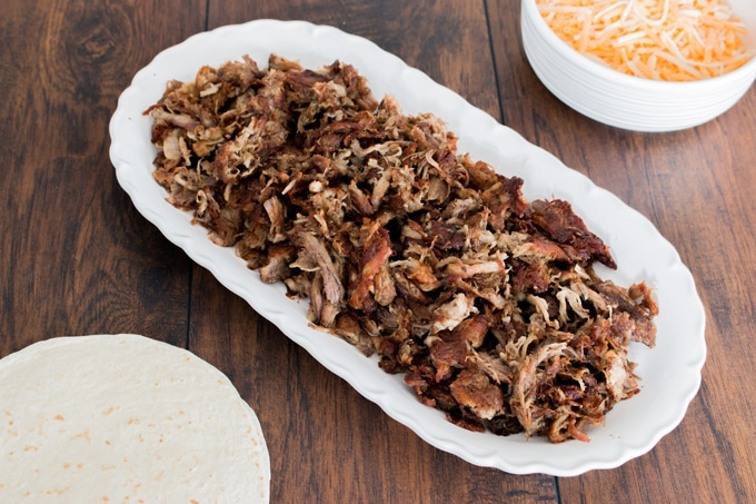 The easiest way to delicious pork carnitas that are incredibly tender and juicy, but still have that traditional crisp crust. It freezes insanely well too, so make a big batch and have a few extra meals for the freezer.