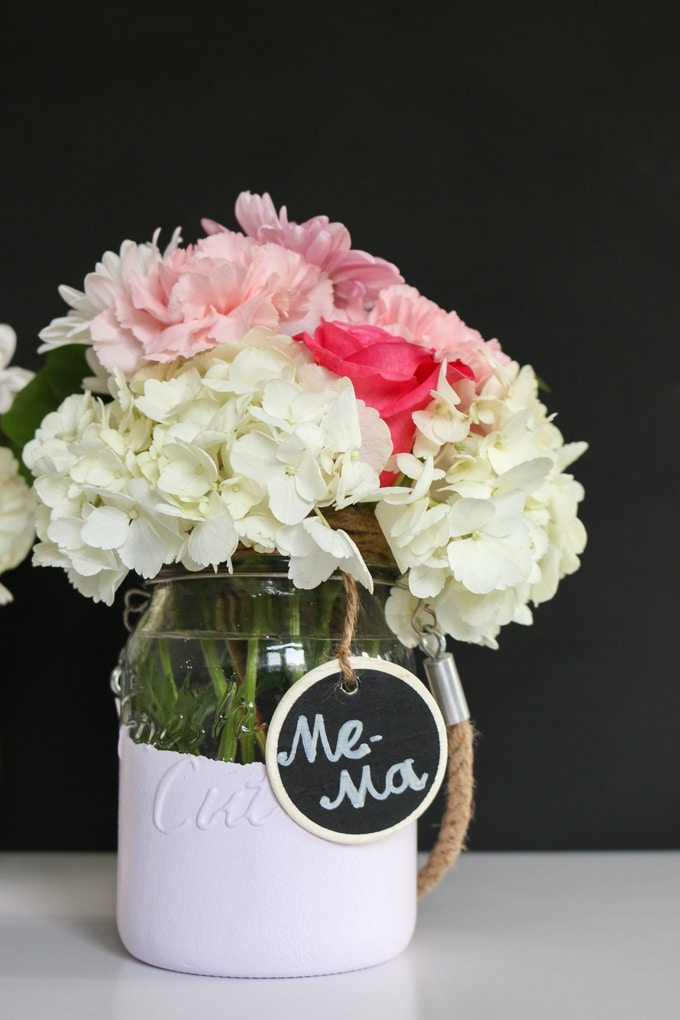 "A super easy way to transform any glass jar by making them look ""dipped"" in paint. They're stunning filled with flowers, lit with a candle, or just used to store odds and ends around the house."