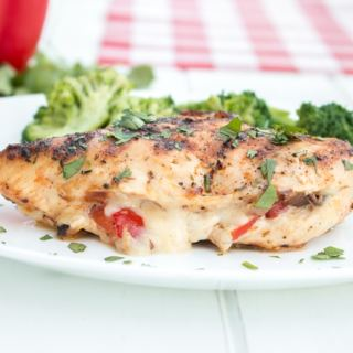 Cajun style chicken breasts stuffed with mozzarella cheese and sautéed peppers and onions, then grilled, make for a quick and easy weeknight meal that's not short on flavour!