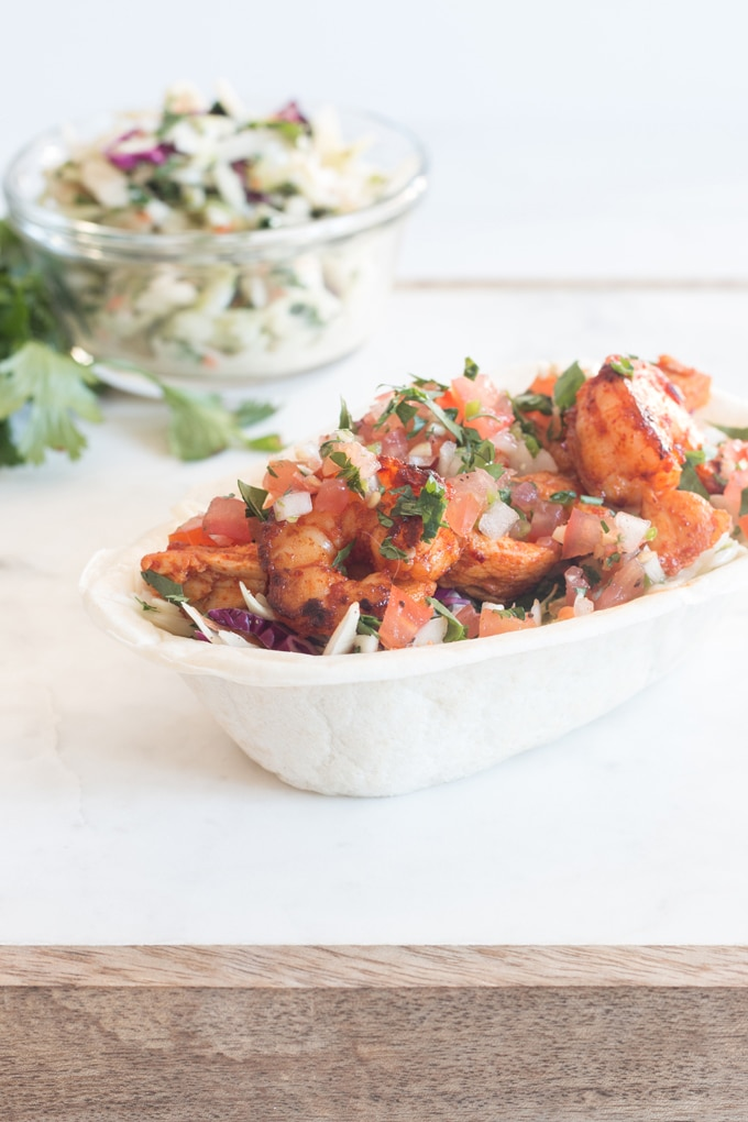 These chili chicken and shrimp tortilla bowls with cilantro slaw and pico de gallo are a great way to pull a meal together fast!