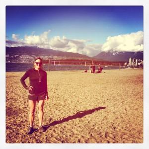 Chelsea enjoys a sunny break on Kits Beach during a run