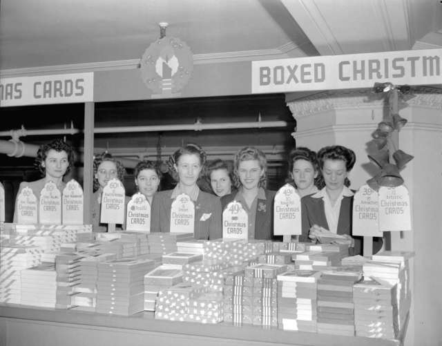 Hudson Bay Company - [clerks behind a display of Christmas cards on the] mezzanine Image: Vancouver Archives