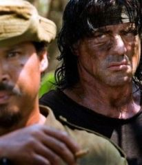 A picture of John Rambo in a combat zone with his preconceived ideas being realised