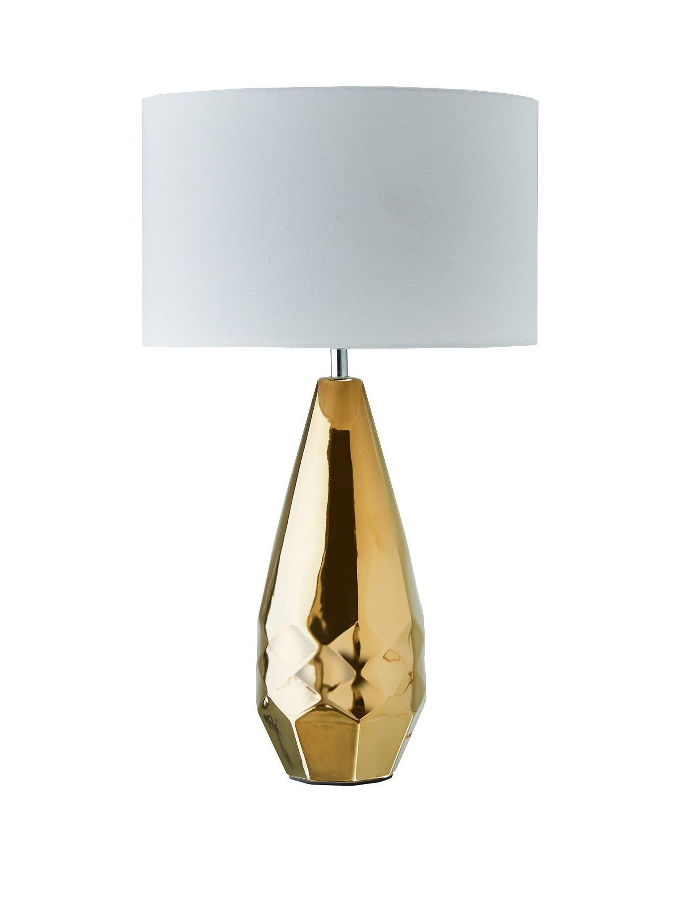 Gold and white geo lamp - home accessories inspiration| Today we're talking inspiration for adding green to your living room. Green is a really versatile colour to decorate your home with. But, which colours and tones work well? What kind of accessories work with green? This post gives you ideas for pulling together an elegant green colour palette and pieces for your home. Read more: kittyandb.com #homeaccessories #lamp #goldandwhite #interiordecoratinginspiration