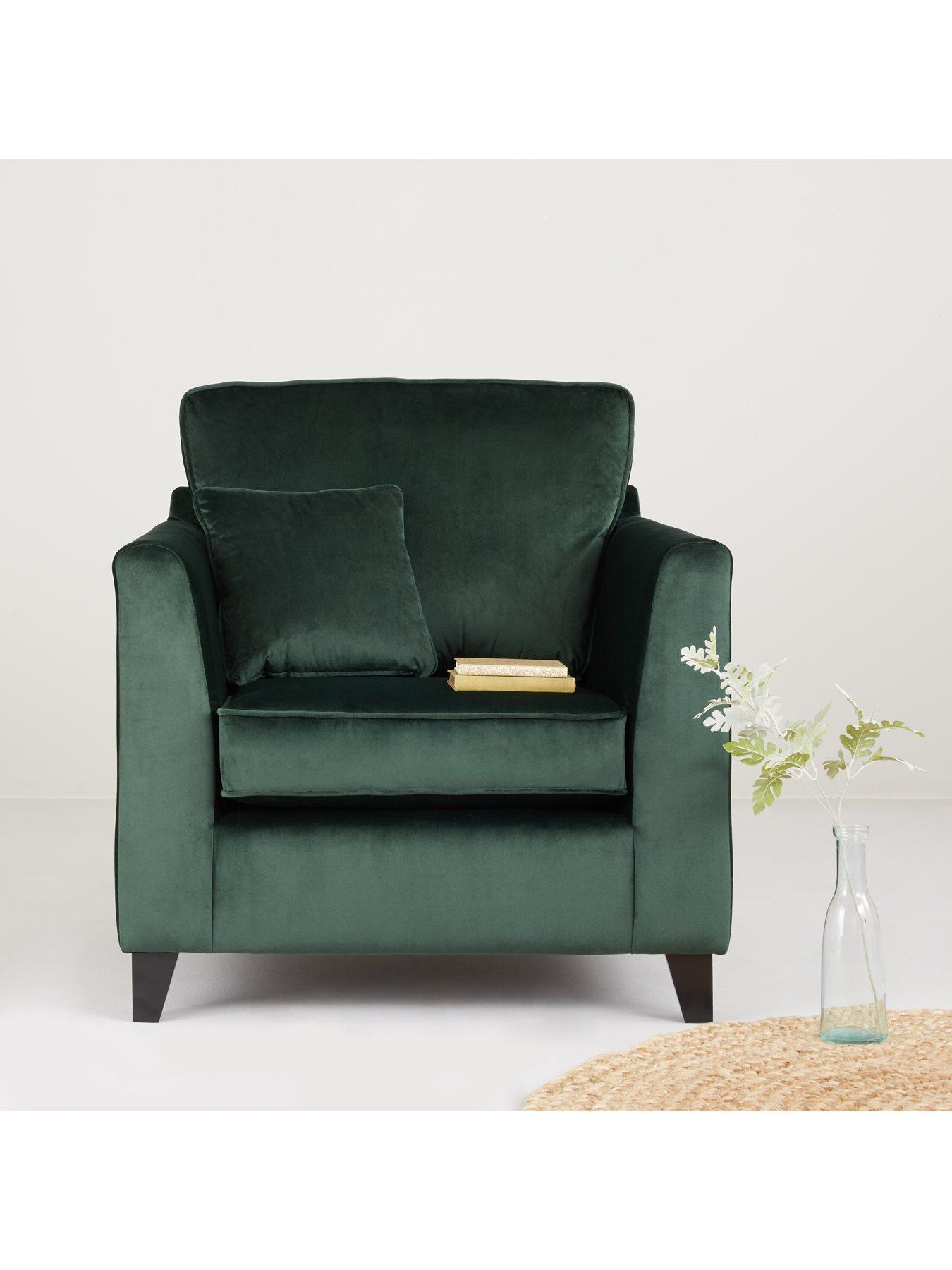 Green velvet armchair - home accessories inspiration| Today we're talking inspiration for adding green to your living room. Green is a really versatile colour to decorate your home with. But, which colours and tones work well? What kind of accessories work with green? This post gives you ideas for pulling together an elegant green colour palette and pieces for your home. Read more: kittyandb.com #greenlivingroom #greenaccessories #greencolorpalette #interiordecoratinginspiration #greenaesthetic #greenarmchair