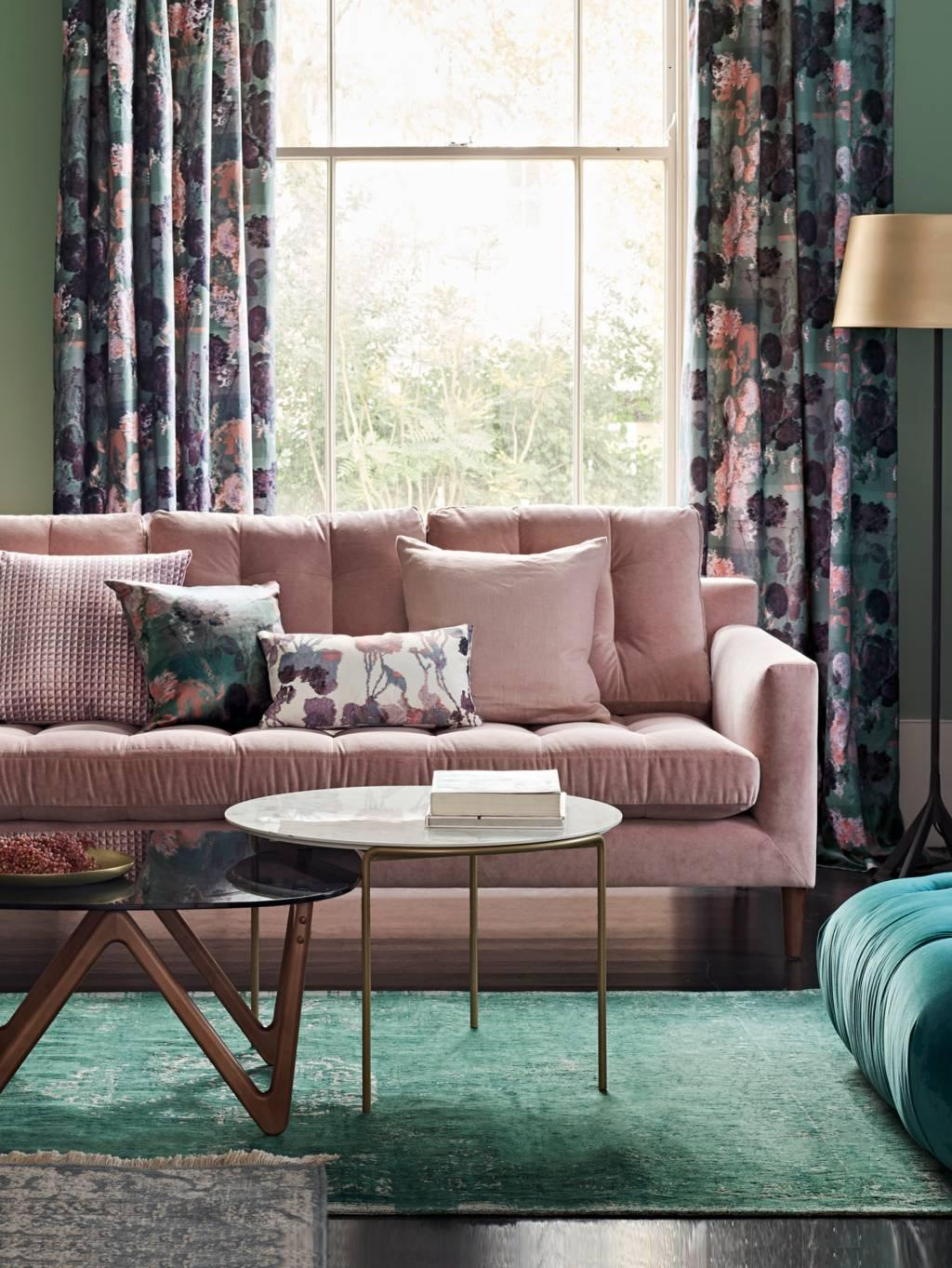 Pink and green living room inspiration| Today we're talking inspiration for adding green to your living room. Green is a really versatile colour to decorate your home with. But, which colours and tones work well? What kind of accessories work with green? This post gives you ideas for pulling together an elegant green colour palette and pieces for your home. Read more: kittyandb.com #greenlivingroom #interiordecoratinginspiration #greenaesthetic #pinksofa #greenwalls #Pinkandgreen