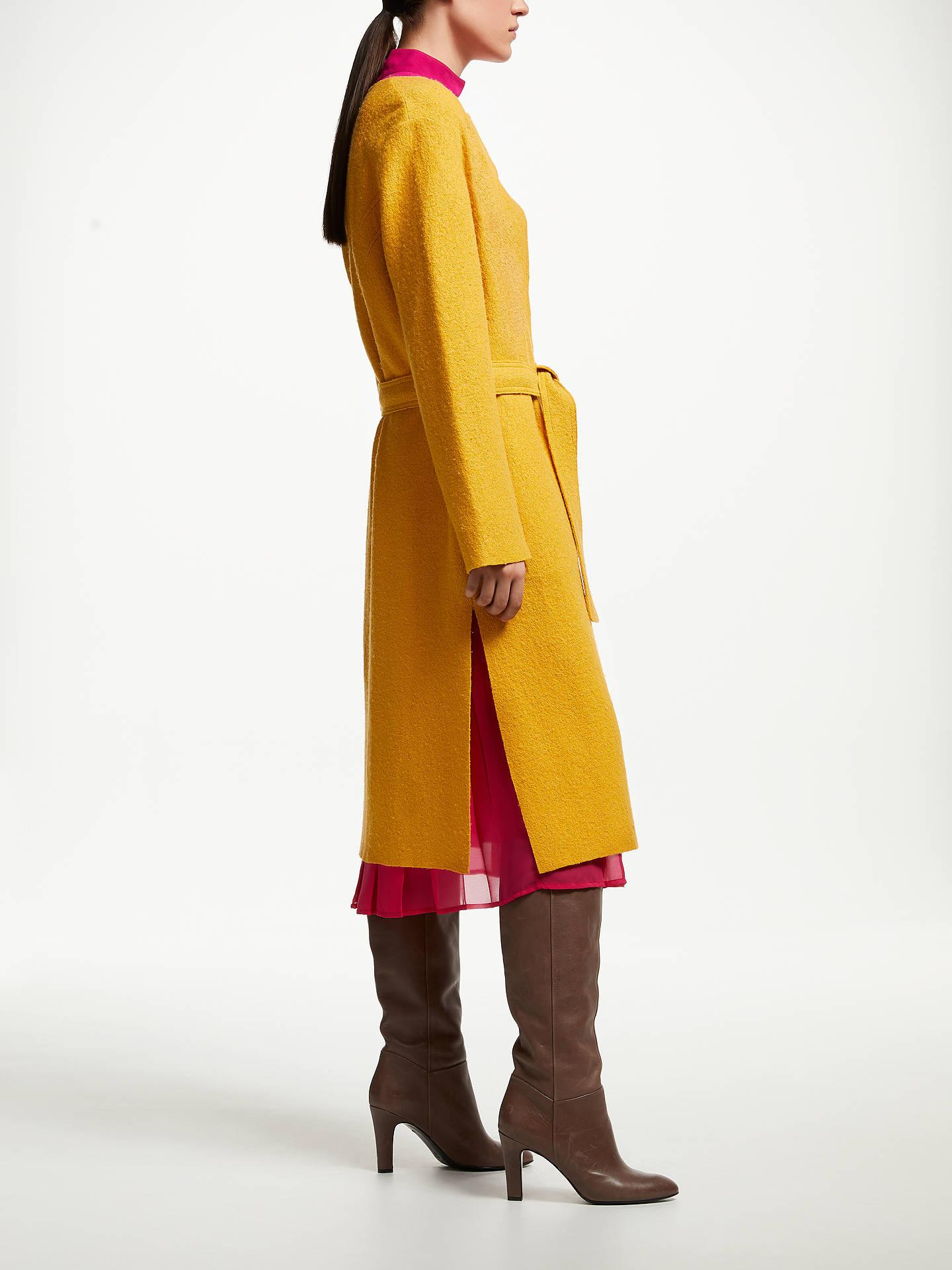 This yellow wool blend coatigan works beautifully with the pink dress and chocolate brown boots | More ideas and colours to wear with brown from kittyandb.com | #brown #yellowcoat #kneeboots #brownoutfit