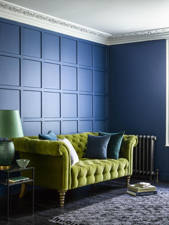 Olive Green Sofa against Blue Walls | Green Living Room Ideas | kittyandb.com | #greensofa #greenandblue #colourfulhomedecor #greenlivingroom
