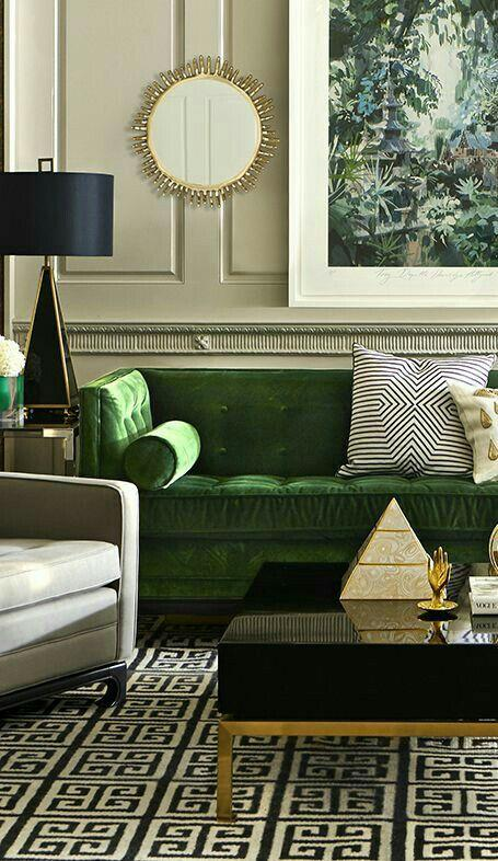 Green Sofa with Gold highlights and black and white geometric print accessories