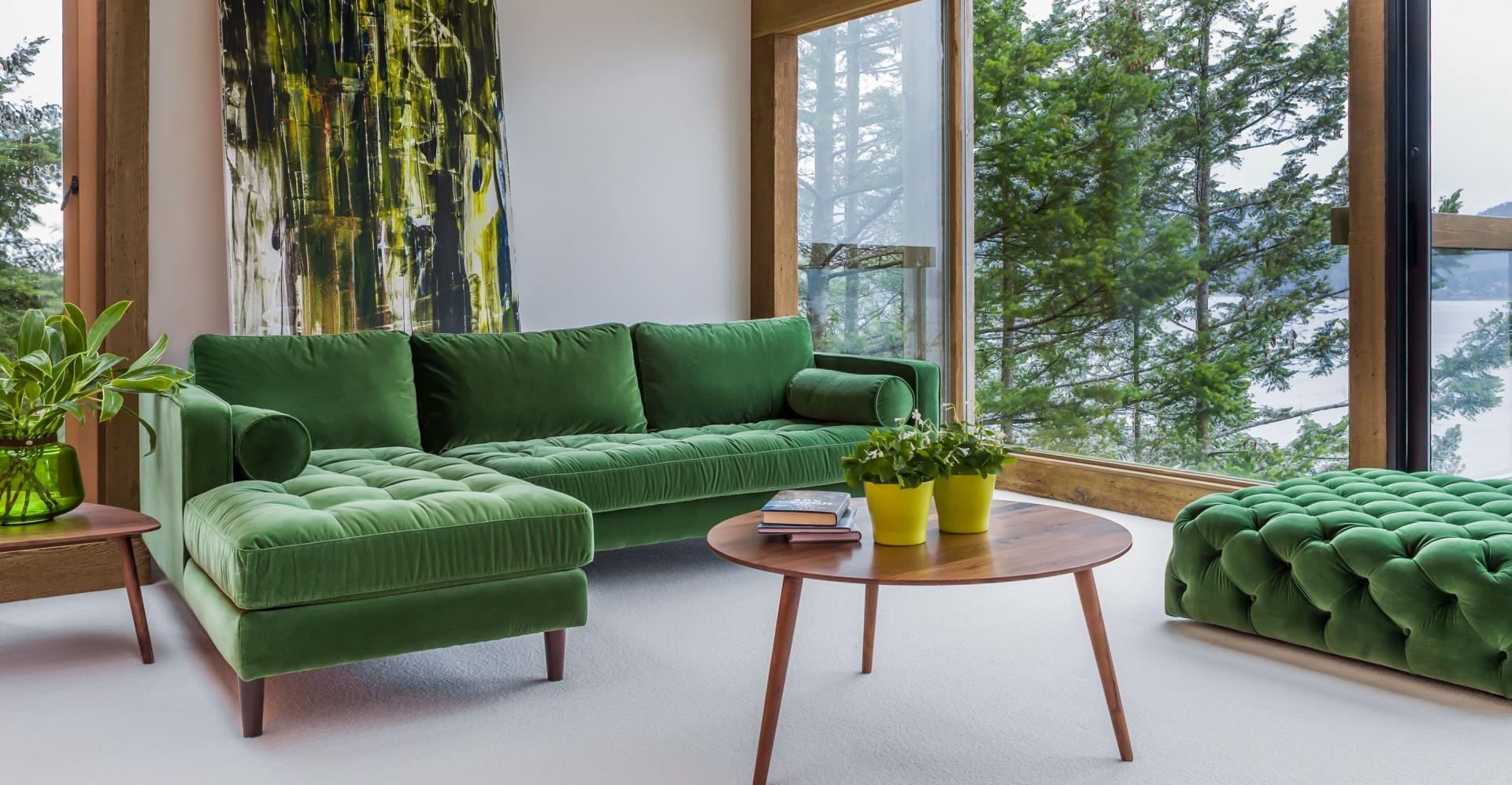Green Sectional Sofa in Neutral and Wood Living Room