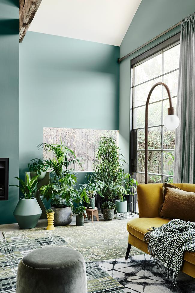 Natural Green and Yellow Living Room Inspiration| Today we're talking inspiration for a green living room. Green is a really versatile colour to decorate your home with. But, which colours and tones work well? What kind of accessories work with green? This post gives you ideas for pulling together an elegant green colour palette and pieces for your home. Read more: kittyandb.com #greenlivingroom #greencolorpalette #roomdecor #greenaesthetic #greenandyellow #plantdecor