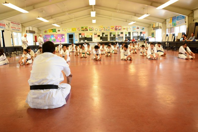 Participants warm-up during a 3-hour seminar, a day before the tournament