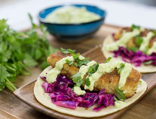 These Kodiak Cakes Fish Tacos are made with pancake batter, fried in coconut oil and spiced up with a little Cajun kick!